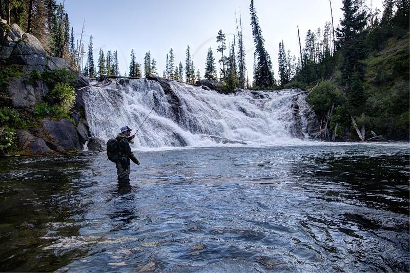 Fishing below the falls. photo