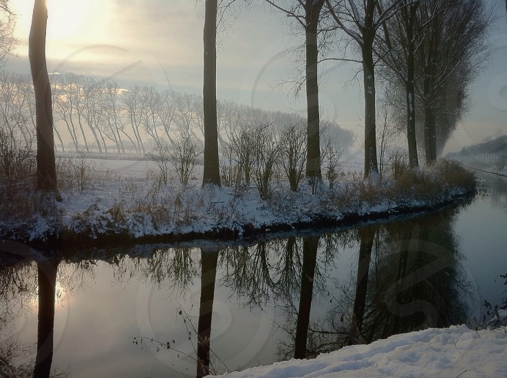 river view on snow coated grasses photo