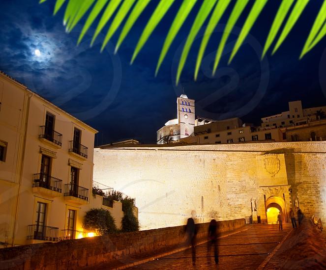 Eivissa Ibiza town with night moon castle entrance and Church photo