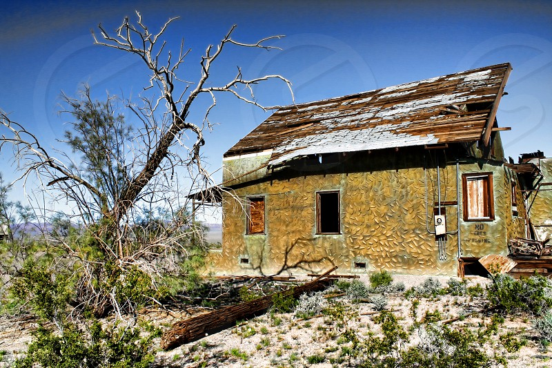 Abandoned home in the desert. photo