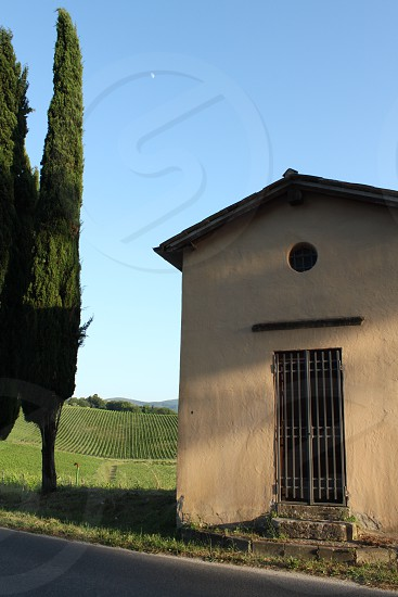 Little chapel in a Tuscan countryside photo