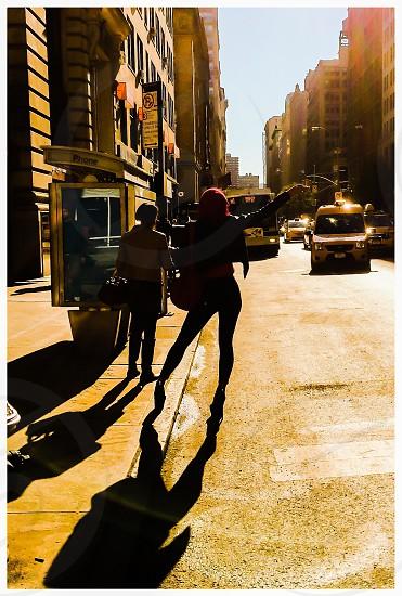 silhouette of woman in high heels on sidewalk photo