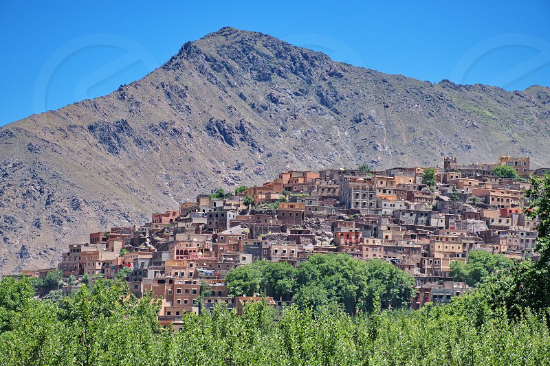 Townscape of Imlil in Morocco with High Atlas mountains in the background photo
