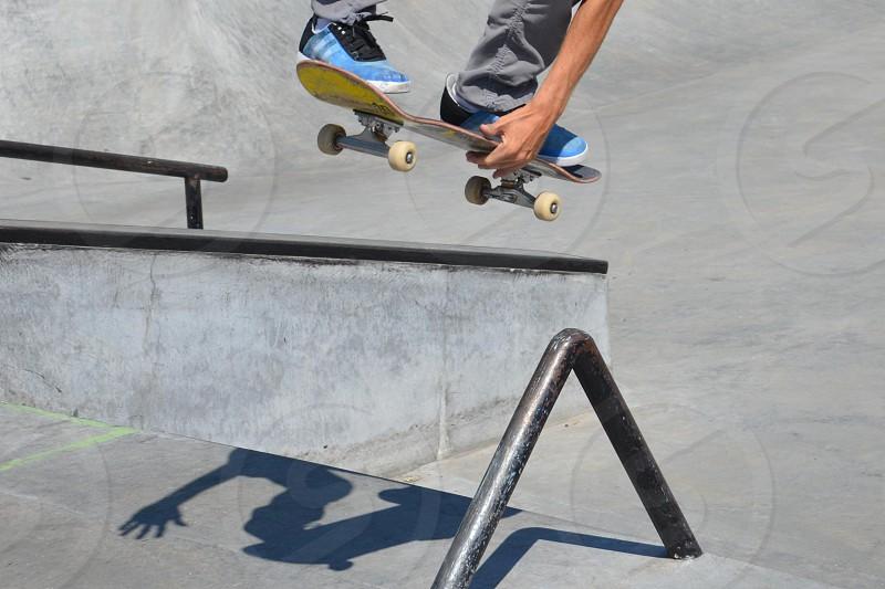 Yellow Skateboard Blue Shoes Shadow Jump photo