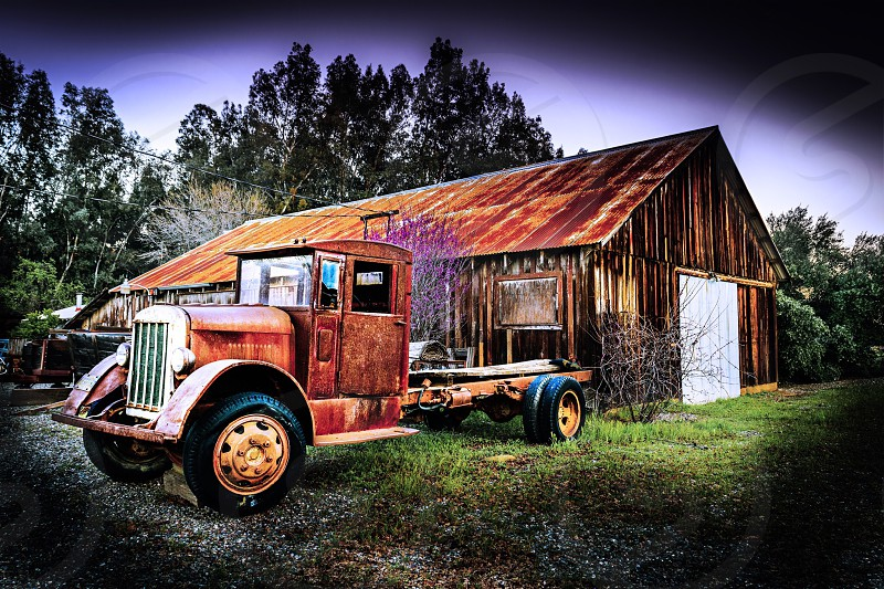 brown freight truck beside brown wooden house photo