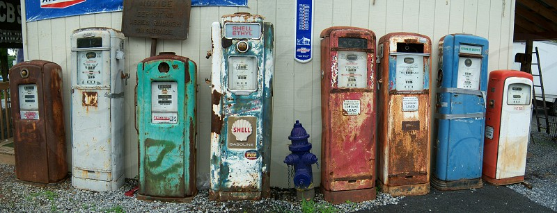 Old gas pumps pano photo