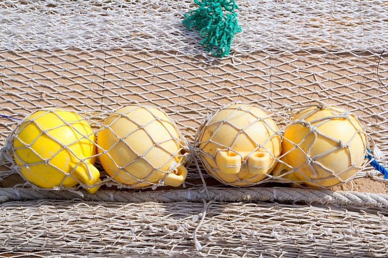 fishing tackle net detail with yellow four buoys photo