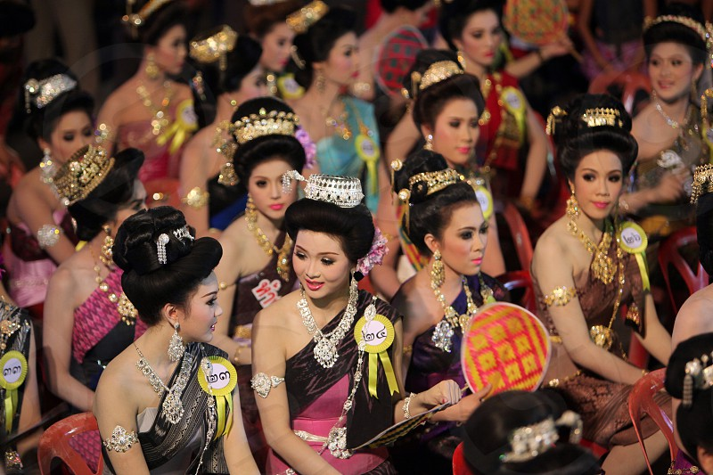 women on a Beauty Miss competition at the Bun Bang Fai Festival or Rocket Festival in the City of Yasothon in the Region of Isan in Northeast Thailand in Thailand.