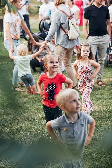 Lublin / Poland - June 22 2019: Children dancing together during open air party on Saint John's Eve day in Open Air Village Museum in Lublin photo