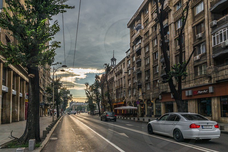 BUCHAREST ROMANIA - 07.20.2018. Old Center of Bucharest Romania in a cloudy summer morning. Sullen and unpleasant atmosphere dirty streets and shabby buildings. photo