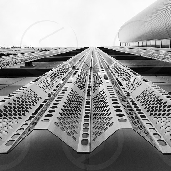 black and white photo of lower angle view building photo