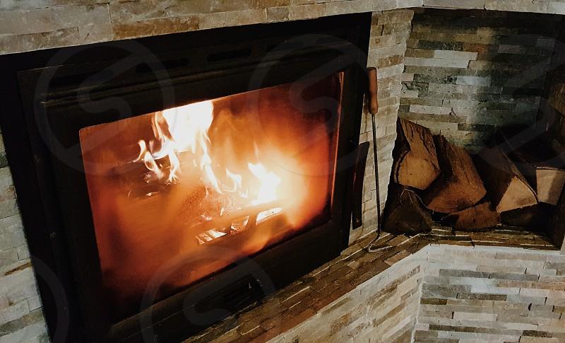 Fire burning inside a fireplace. photo