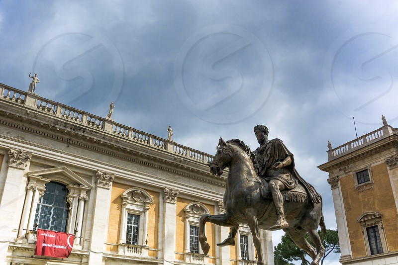 The Equestrian Statue of Marcus Aurelius is an ancient Roman statue in the Campidoglio Rome Italy. It is made of bronze and stands 4.24 m tall. Although the emperor is mounted it exhibits many similarities to standing statues of Augustus. The original is on display in the Capitoline Museums with the one now standing in the open air of the Piazza del Campidoglio being a replica made in 1981 when the original was taken down for restoration. photo