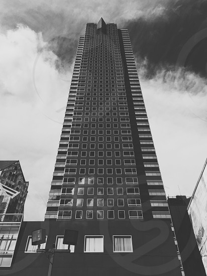 building and sky in black and white photo