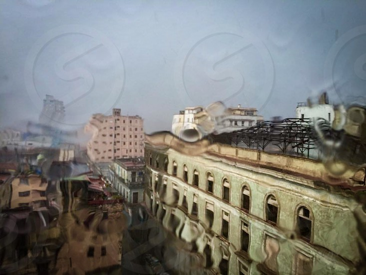 Indoor day Horizontal colour storm rain raindrops water window rainy tropical Havana Cuba Caribbean photo
