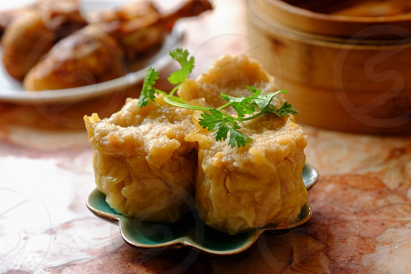 Shumai (simplified Chinese: 烧卖; traditional Chinese: 燒賣; pinyin: shāomài; Jyutping: siu1 maai2; Cantonese Yale: sīumáai) is a type of traditional Chinese dumpling originating from Huhhot. In Cantonese cuisine it is usually served as a dim sum snack.[1] In addition to accompanying the Chinese diaspora a variation of Shaomai also appears in Japan (焼売 Shūmai) and various Southeast Asian countries. photo