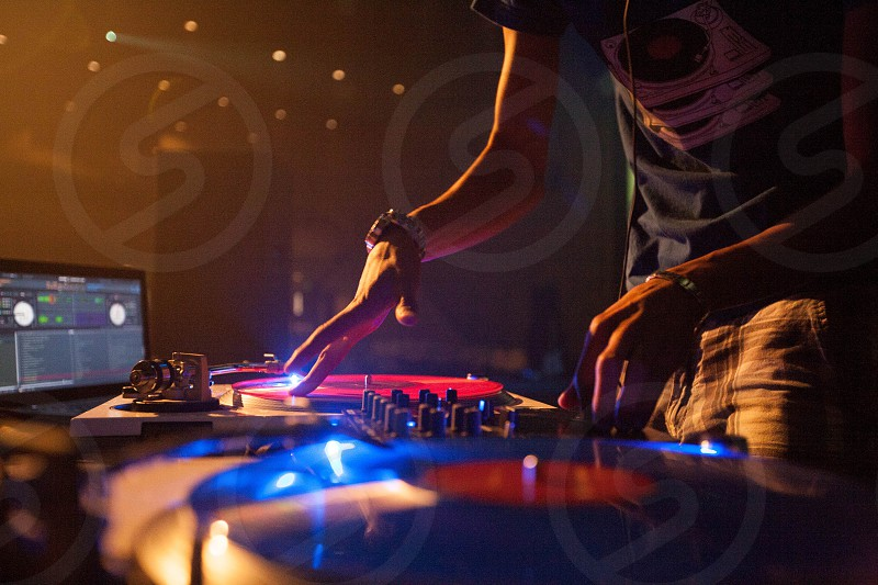 deejay on turntables spinning records photo
