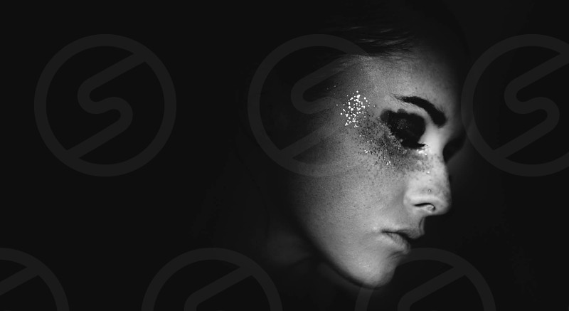 black and white woman's face with glitters photo