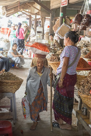 a old women at a marketstreet in the City of Mandalay in Myanmar in Southeastasia. photo