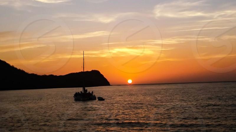 Sailboat sunset boating water island nature photo