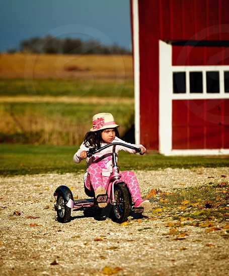 Free freedom ride riding bike child children play playing fun  time young  youth tricycle country countrysideoutdoor outdoors colorful colors color   photo