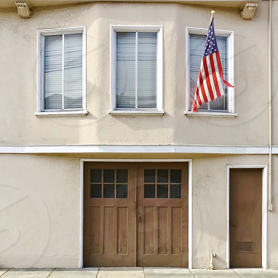 House with American flag photo