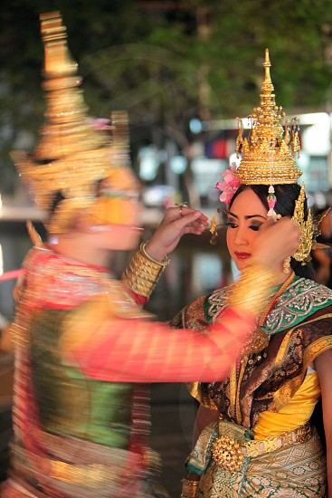 a traditional dance group in a park in the city of chiang mai in the north of Thailand in Southeastasia.  photo