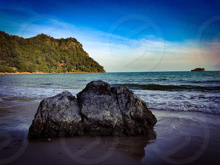 beach sea seaside wave breeze sand ocean clear turquoise blue green island silence peace alone calm relax empty Thailand Chumphon rock stone photo