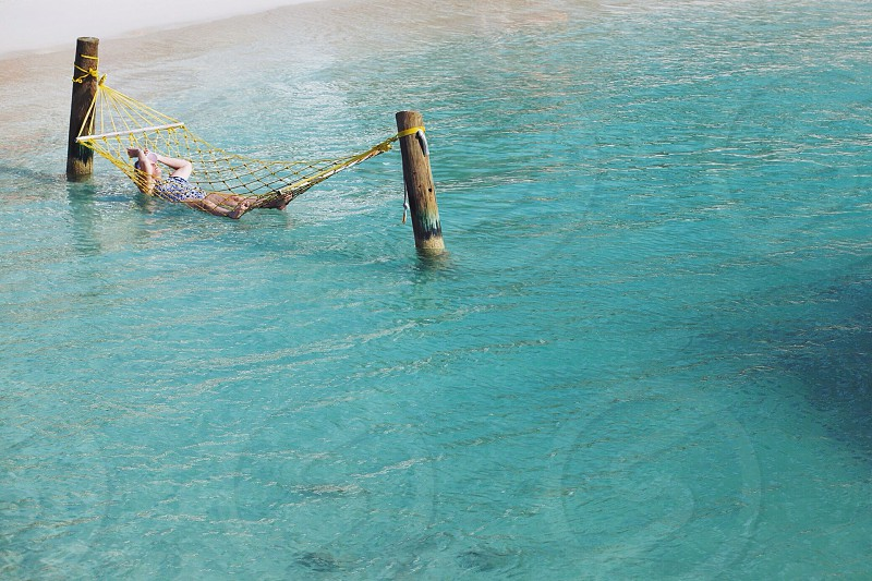 red wooden swing in the sea photograph photo