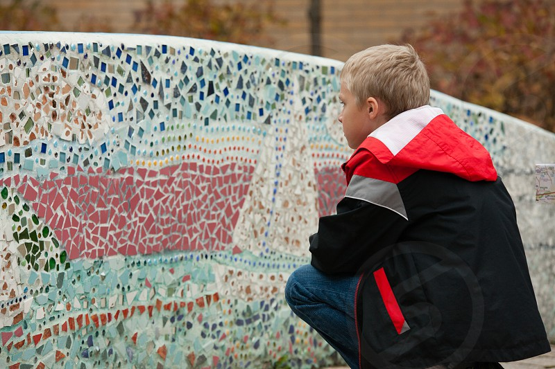 Auburn NY Mosaic History's Hometown Auburn Auburn NY Mosaic corridor mosaic boy blonde boy blond boy boy in black and red jacket black and red jacket red black photo