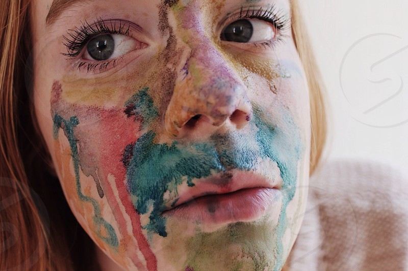 woman with multicolor paint on face photo