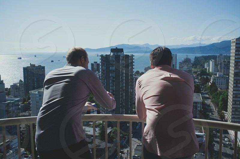 Two pals overlooking Vancouver waterfront. photo