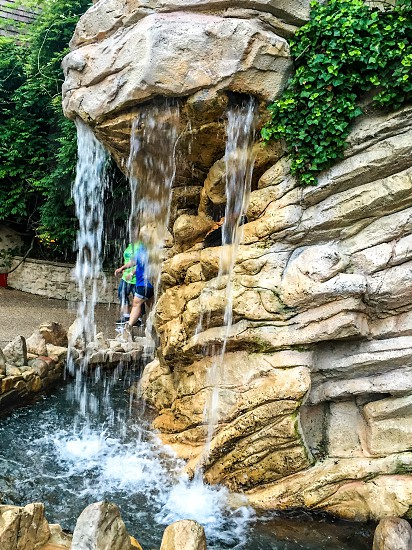 Water fallwater structure rock texture plants greenery photo