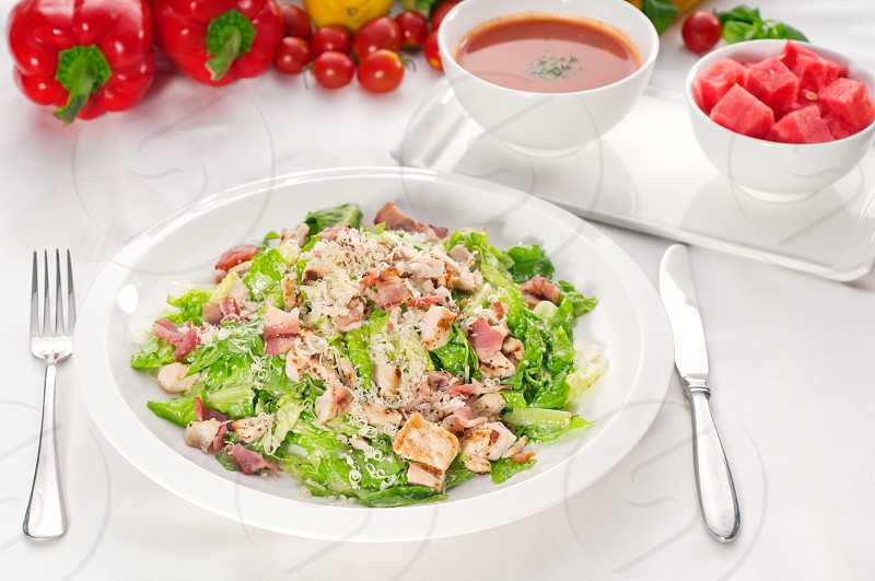 fresh classic caesar salad  served with gazpacho souphealthy meal MORE DELICIOUS FOOD ON PORTFOLIO photo
