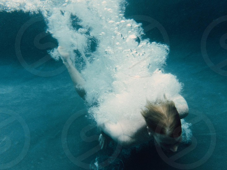human under water photo