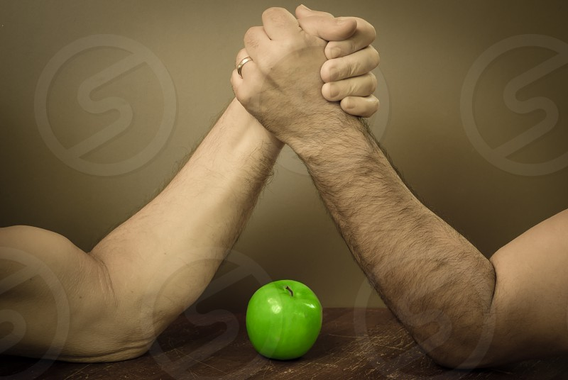 arm arms wrestling apple green strength knowledge muscle masculine manly win success hands gripping grip manliness photo