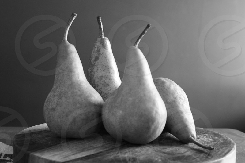 black and white pears fruit cutting board photo