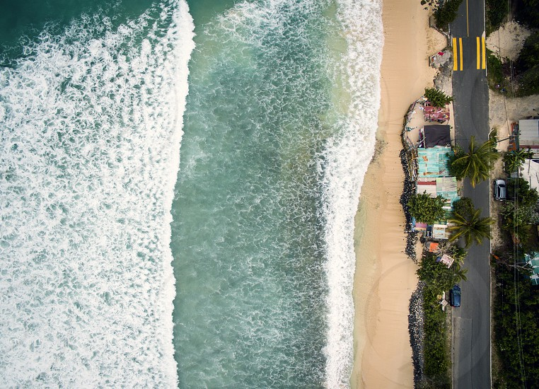 A series of aerial images showing the separation of land and sea photo