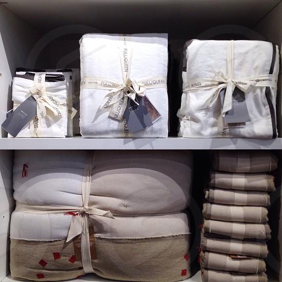 bundled clothes on shelf photo