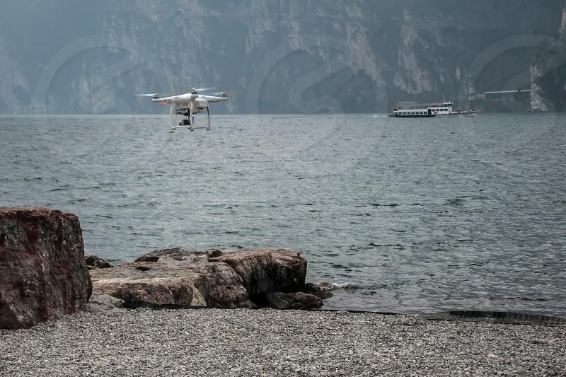 Drone hovering on the Shoreline at Riva del Garda photo