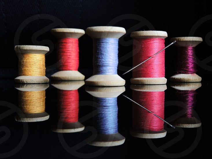 blue thread spool photo