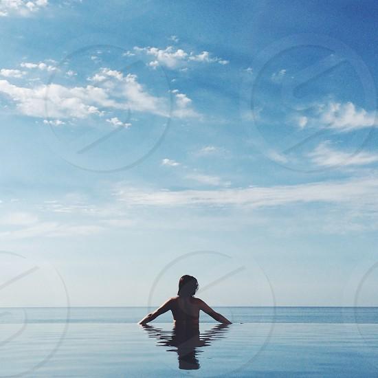 woman overlooking the ocean photo