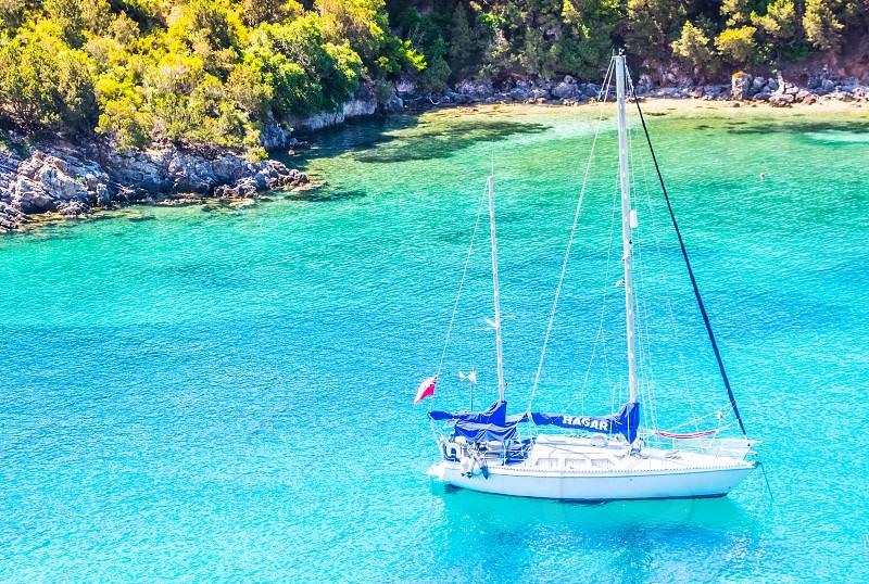Sailing Boat On Turquoise Sea In Sivota Greece photo