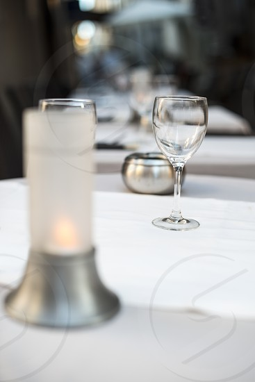 Glass on table in a restaurant. White tablecloth photo