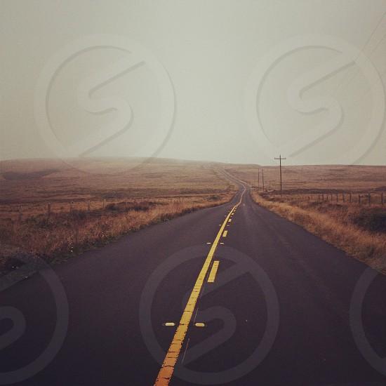 two lane road among brown plains photo