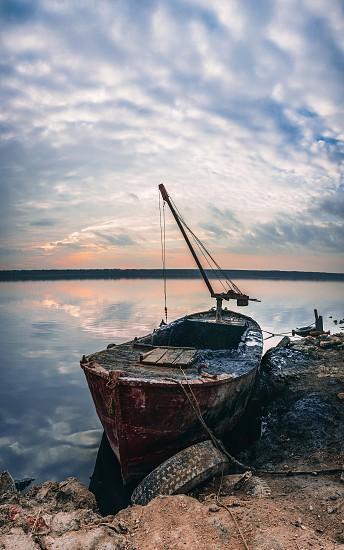 Old boat of the mud getters on the salt lake Kuyalnik in Odessa Ukraine photo