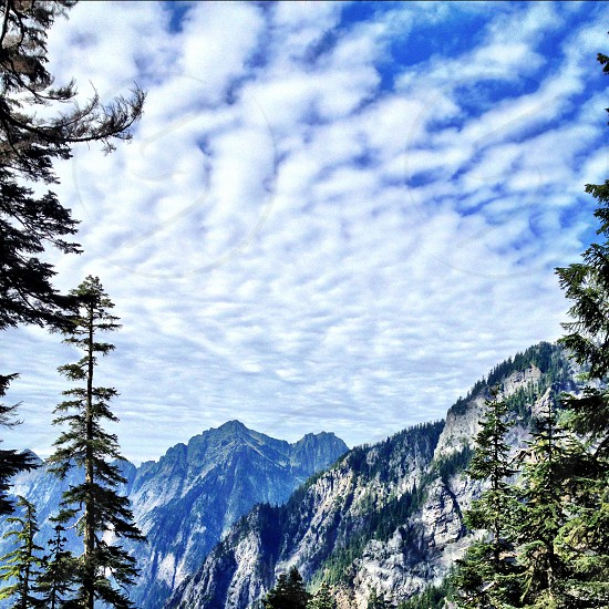 clouds over mountains photo