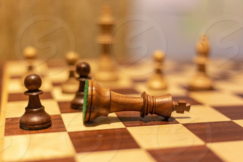 pov point of view chess board pieces game king queen pawn squares check wood photo