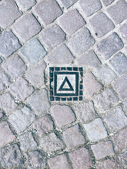 Street triangle symbol on a well lid photo