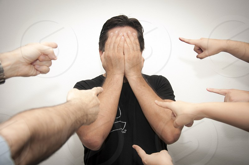 A man feels shame when he is accused photo